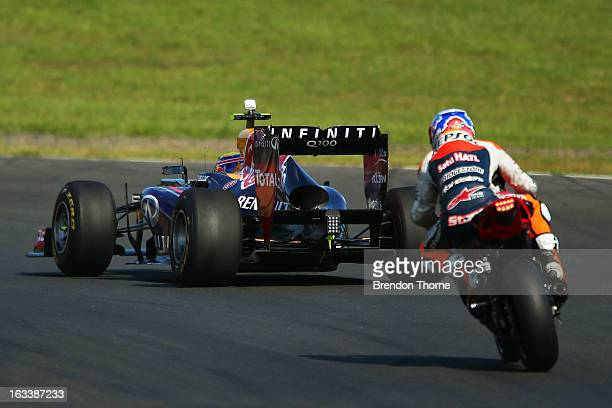 Mark Webber of Australia and Infiniti Red Bull Racing and Casey Stoner of Red Bull Pirtek Holden drive during the Top Gear Festival at Sydney...