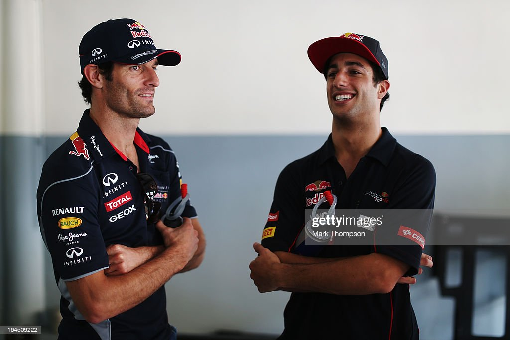 Mark Webber (L) of Australia and Infiniti Red Bull Racing and Daniel Ricciardo (R) of Australia and Scuderia Toro Rosso attend the drivers parade before the Malaysian Formula One Grand Prix at the Sepang Circuit on March 24, 2013 in Kuala Lumpur, Malaysia.