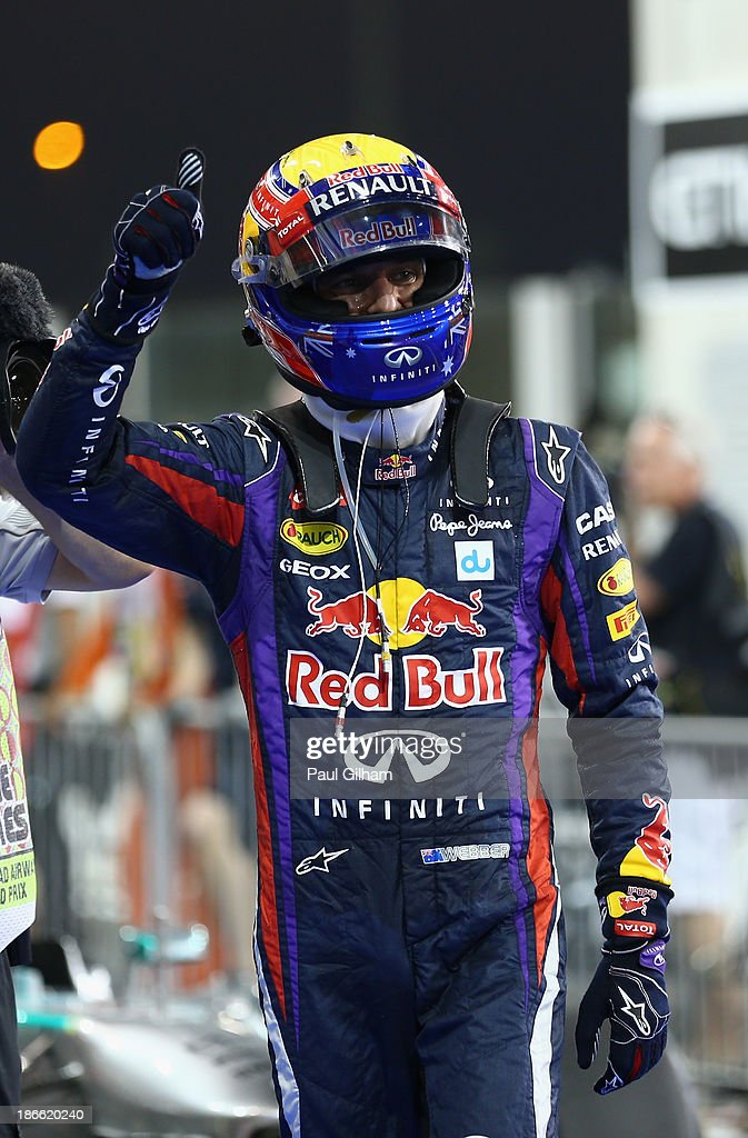 <a gi-track='captionPersonalityLinkClicked' href=/galleries/search?phrase=Mark+Webber+-+Race+Car+Driver&family=editorial&specificpeople=167271 ng-click='$event.stopPropagation()'>Mark Webber</a> of Australia and Infiniti Red Bull Racing celebrates in parc ferme after finishing first during qualifying for the Abu Dhabi Formula One Grand Prix at the Yas Marina Circuit on November 2, 2013 in Abu Dhabi, United Arab Emirates.