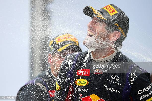 Mark Webber of Australia and Infiniti Red Bull Racing celebrates on the podium after finishing second in his final F1 race following the Brazilian...