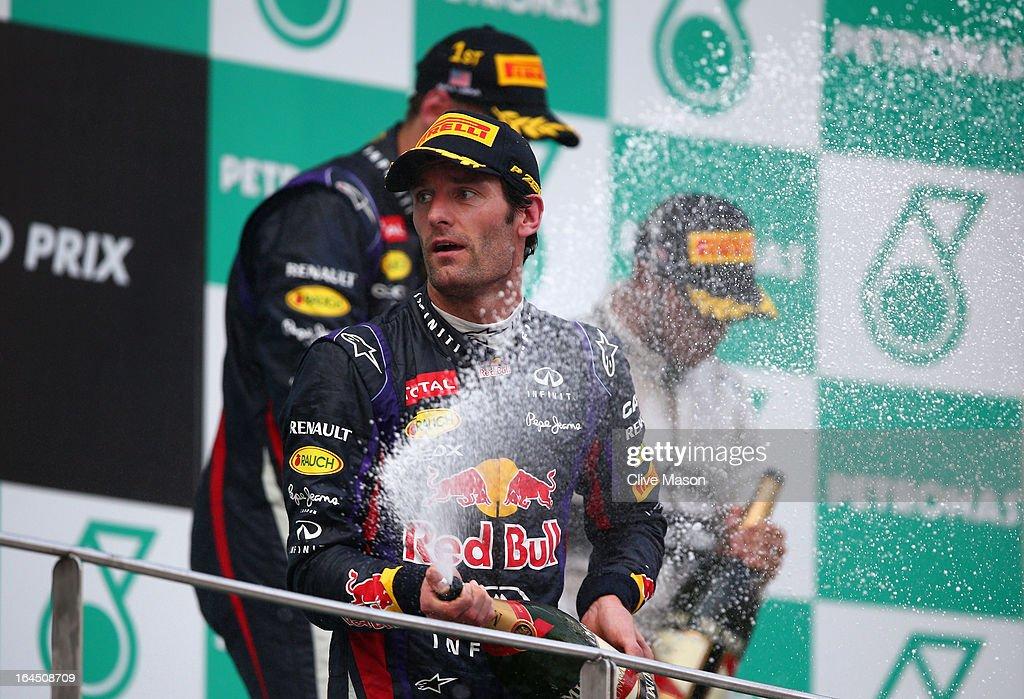 Mark Webber of Australia and Infiniti Red Bull Racing celebrates finishing second following the Malaysian Formula One Grand Prix at the Sepang Circuit on March 24, 2013 in Kuala Lumpur, Malaysia.