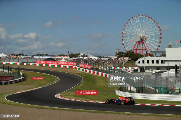 Mark Webber of Australia and Infiniti Red Bull Racing drives during qualifying for the Japanese Formula One Grand Prix at Suzuka Circuit on October...