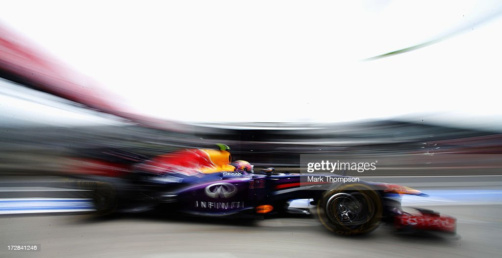 <a gi-track='captionPersonalityLinkClicked' href=/galleries/search?phrase=Mark+Webber+-+Pilota+di+auto+da+corsa&family=editorial&specificpeople=167271 ng-click='$event.stopPropagation()'>Mark Webber</a> of Australia and Infiniti Red Bull Racing drives into the pitlane during practice for the German Grand Prix at the Nuerburgring on July 5, 2013 in Nuerburg, Germany.