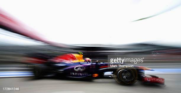 Mark Webber of Australia and Infiniti Red Bull Racing drives into the pitlane during practice for the German Grand Prix at the Nuerburgring on July 5...
