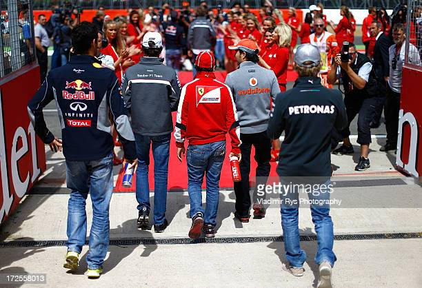 Mark Webber of Australia and Infiniti Red Bull Racing Esteban Gutierrez of Mexico and Sauber Felipe Massa of Brazil and Ferrari Sergio Perez of...