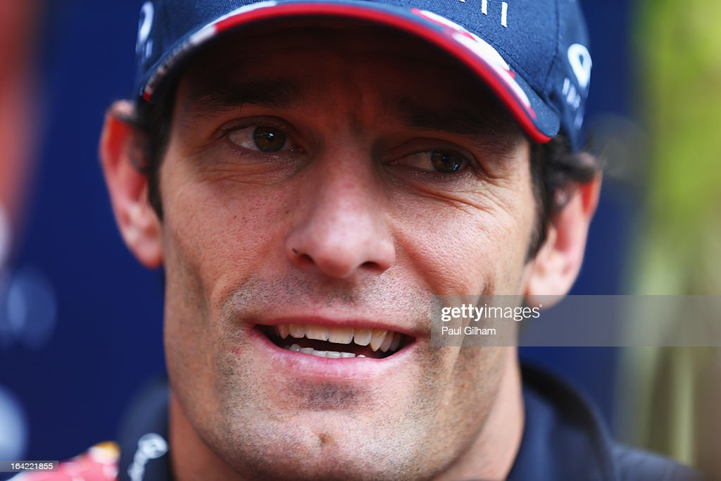 Mark Webber of Australia and Infiniti Red Bull Racing is interviewed in the paddock during previews to the Malaysian Formula One Grand Prix at the Sepang Circuit on March 21, 2013 in Kuala Lumpur, Malaysia.