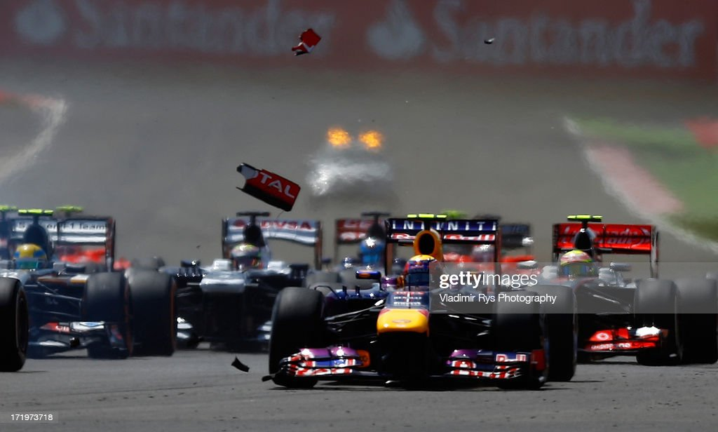 <a gi-track='captionPersonalityLinkClicked' href=/galleries/search?phrase=Mark+Webber+-+Racerf%C3%B6rare&family=editorial&specificpeople=167271 ng-click='$event.stopPropagation()'>Mark Webber</a> of Australia and Infiniti Red Bull Racing is pictured during the start of the British Formula One Grand Prix at Silverstone Circuit on June 30, 2013 in Northampton, England.