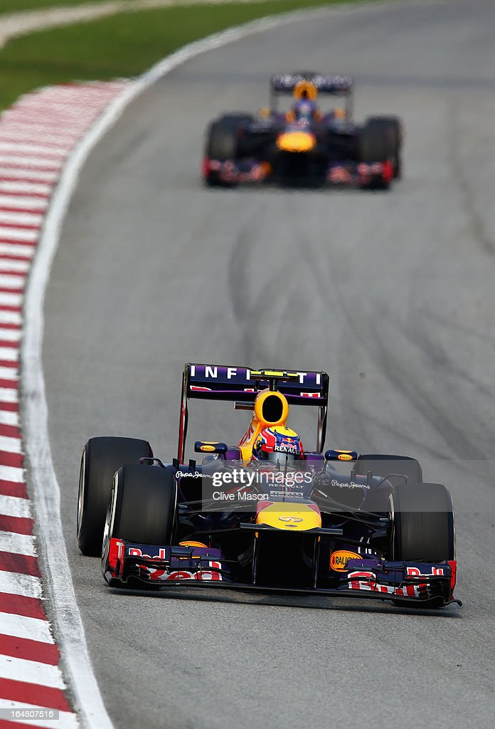 Mark Webber of Australia and Infiniti Red Bull Racing leads from Sebastian Vettel of Germany and Infiniti Red Bull Racing during the Malaysian...