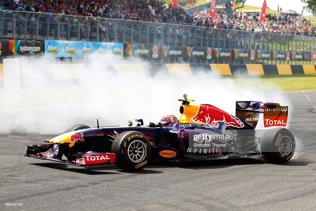 <a gi-track='captionPersonalityLinkClicked' href=/galleries/search?phrase=Mark+Webber+-+Race+Car+Driver&family=editorial&specificpeople=167271 ng-click='$event.stopPropagation()'>Mark Webber</a> of Australia and Infiniti Red Bull Racing performs a donut during the Top Gear Festival at Sydney Motorsport Park on March 10, 2013 in Sydney, Australia.