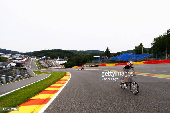 Mark Webber of Australia and Infiniti Red Bull Racing rides his bike round the circuit during previews to the Belgian Grand Prix at Circuit de...