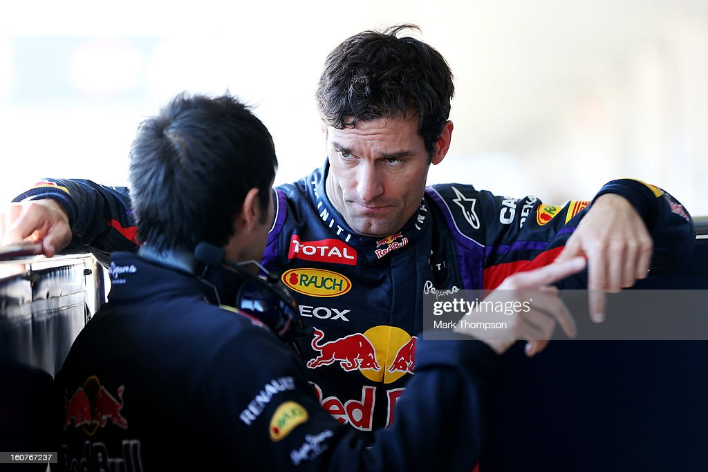 Mark Webber of Australia and Infiniti Red Bull Racing speaks with his trainer, Richard Conor during Formula One winter testing at Circuito de Jerez on February 5, 2013 in Jerez de la Frontera, Spain.