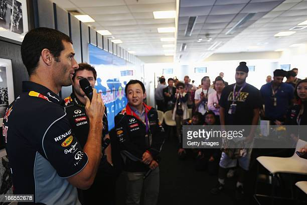 Mark Webber of Australia and Infiniti Red Bull Racing talks to guests in the paddock club before the Chinese Formula One Grand Prix at the Shanghai...