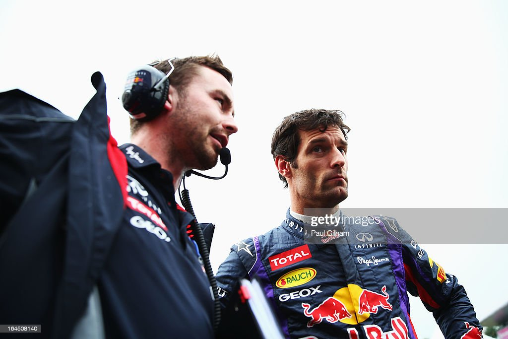 Mark Webber of Australia and Infiniti Red Bull Racing talks with his race engineer Simon Rennie as he prepares to drive during the Malaysian Formula One Grand Prix at the Sepang Circuit on March 24, 2013 in Kuala Lumpur, Malaysia.