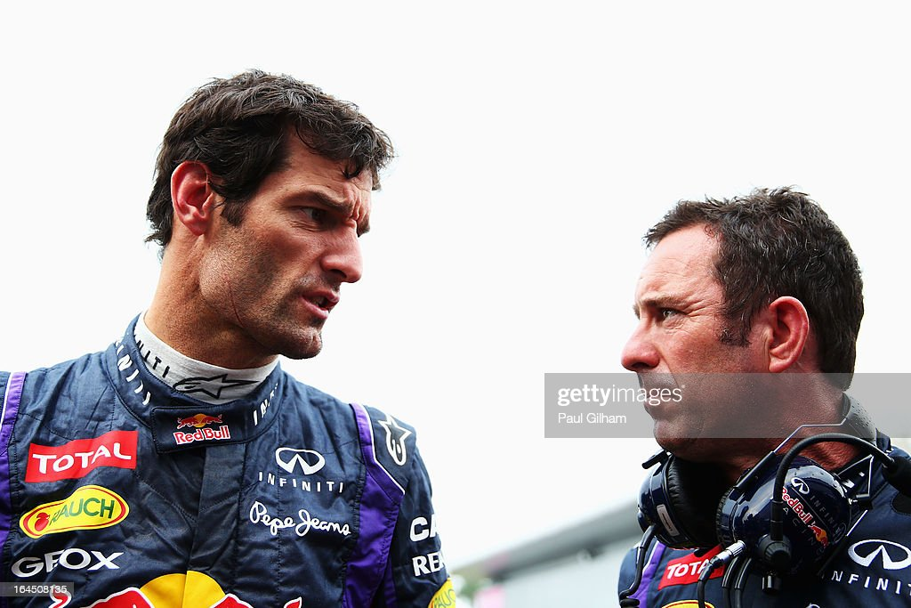 Mark Webber of Australia and Infiniti Red Bull Racing talks with Chief Mechanic Kenny Handkammer as he prepares to drive during the Malaysian Formula One Grand Prix at the Sepang Circuit on March 24, 2013 in Kuala Lumpur, Malaysia.