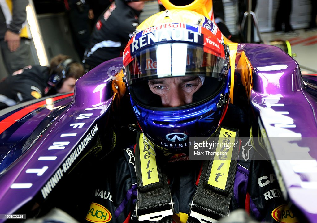 Mark Webber of Australia and Infiniti Red Bull Racing waits in the team garage during Formula One winter testing at Circuito de Jerez on February 6, 2013 in Jerez de la Frontera, Spain.
