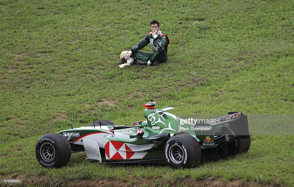 Mark Webber of Australia and Jaguar watches the race after crashing out of the Formula One Brazilian Grand Prix at Interlagos on October 24 2004 in...