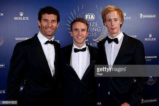 Mark Webber of Australia and Porsche Timo Bernhard of Germany and Porsche and Brendon Hartley of New Zealand and Porsche pose after collecting the...