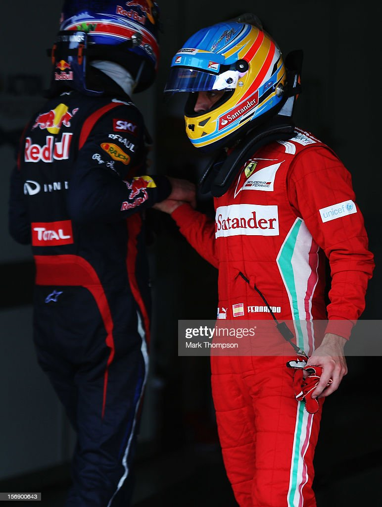 Mark Webber (L) of Australia and Red Bull Racing and Fernando Alonso (R) of Spain and Ferrari shake hands in parc ferme following qualifying for the Brazilian Formula One Grand Prix at the Autodromo Jose Carlos Pace on November 24, 2012 in Sao Paulo, Brazil.