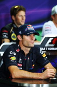 Mark Webber of Australia and Red Bull Racing and Romain Grosjean of France and Lotus attend the drivers press conference during previews for the...