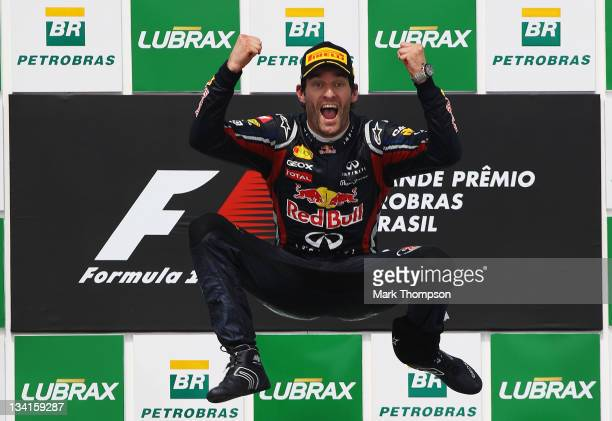 Mark Webber of Australia and Red Bull Racing celebrates on the podium after winning the the Brazilian Formula One Grand Prix at the Autodromo Jose...