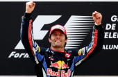 Mark Webber of Australia and Red Bull Racing celebrates on the podium after winning the Spanish Formula One Grand Prix at the Circuit de Catalunya on...