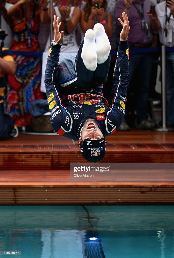 <a gi-track='captionPersonalityLinkClicked' href=/galleries/search?phrase=Mark+Webber+-+Race+Car+Driver&family=editorial&specificpeople=167271 ng-click='$event.stopPropagation()'>Mark Webber</a> of Australia and Red Bull Racing celebrates winning the race by jumping into the swimming pool on the Red Bull Energy Station following the Monaco Formula One Grand Prix at the Circuit de Monaco on May 27, 2012 in Monte Carlo, Monaco.