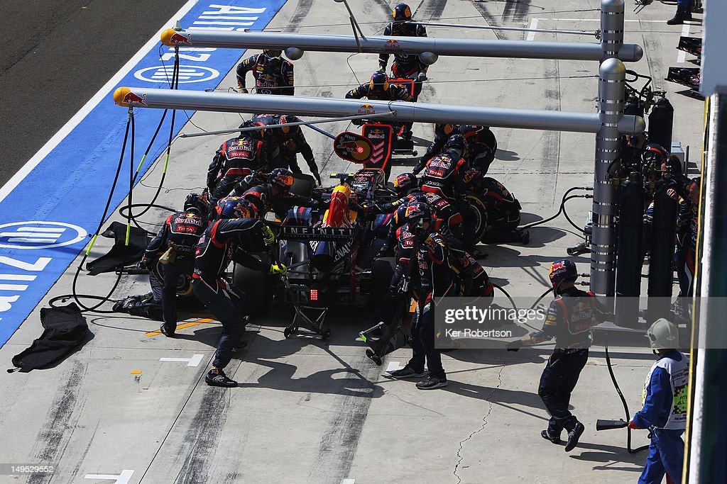 Mark Webber of Australia and Red Bull Racing drives in for a pitstop during the Hungarian Formula One Grand Prix at the Hungaroring on July 29, 2012 in Budapest, Hungary.