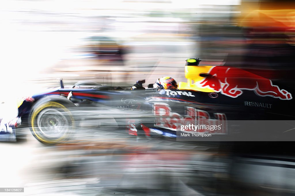 <a gi-track='captionPersonalityLinkClicked' href=/galleries/search?phrase=Mark+Webber+-+Race+Car+Driver&family=editorial&specificpeople=167271 ng-click='$event.stopPropagation()'>Mark Webber</a> of Australia and Red Bull Racing exits his team garage during qualifying for the Brazilian Formula One Grand Prix at the Autodromo Jose Carlos Pace on November 26, 2011 in Sao Paulo, Brazil.