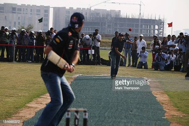 Mark Webber of Australia and Red Bull Racing faces up to the bowling of Indian cricketer Gautam Gambhir during previews for the Indian Formula One...