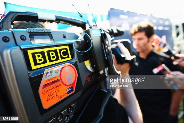 Mark Webber of Australia and Red Bull Racing is interviewed by the BBC in the paddock during previews to the Australian Formula One Grand Prix at the...