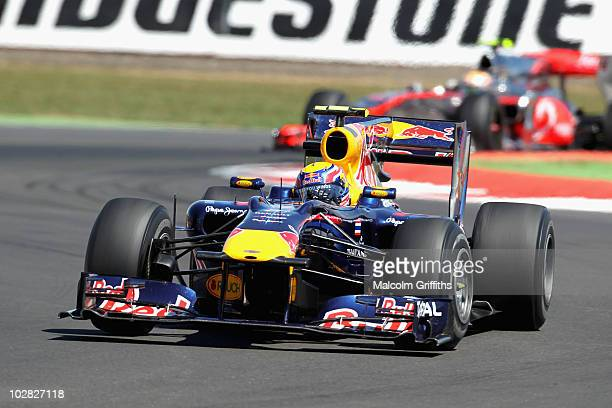 Mark Webber of Australia and Red Bull Racing leads from Lewis Hamilton of Great Britain and McLaren Mercedes during the British Formula One Grand...