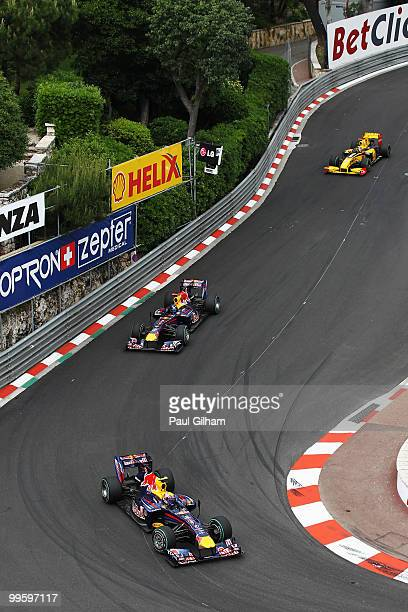 Mark Webber of Australia and Red Bull Racing leads from Sebastian Vettel of Germany and Red Bull Racing and Robert Kubica of Poland and Renault as he...