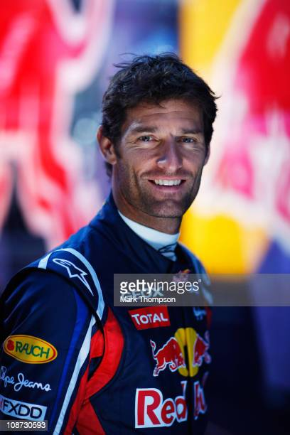 Mark Webber of Australia and Red Bull Racing poses for a photograph behind his team garage during day two of winter testing at the Ricardo Tormo...