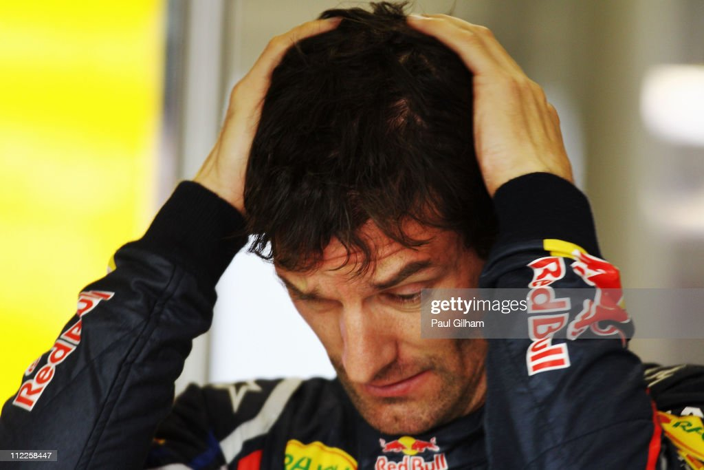 <a gi-track='captionPersonalityLinkClicked' href=/galleries/search?phrase=Mark+Webber+-+Racerf%C3%B6rare&family=editorial&specificpeople=167271 ng-click='$event.stopPropagation()'>Mark Webber</a> of Australia and Red Bull Racing reacts in his team garage before qualifying for the Chinese Formula One Grand Prix at the Shanghai International Circuit on April 16, 2011 in Shanghai, China.