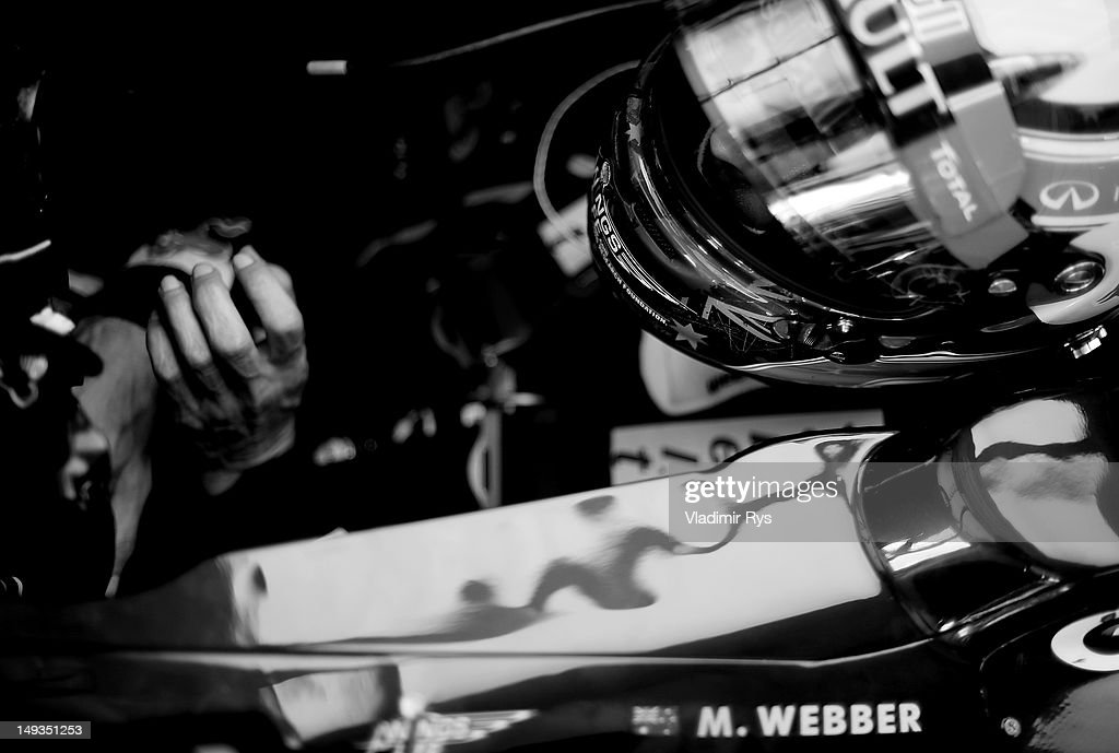 <a gi-track='captionPersonalityLinkClicked' href=/galleries/search?phrase=Mark+Webber+-+Race+Car+Driver&family=editorial&specificpeople=167271 ng-click='$event.stopPropagation()'>Mark Webber</a> of Australia and Red Bull Racing sits in his car in the garage during practice for the Hungarian Formula One Grand Prix at the Hungaroring on July 27, 2012 in Budapest, Hungary.
