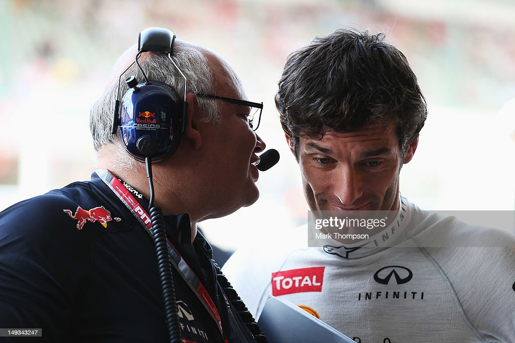 Mark Webber (R) of Australia and Red Bull Racing talks to Red Bull Racing Team Chief Designer Rob Marshall (L) before practice for the Hungarian Formula One Grand Prix at the Hungaroring on July 27, 2012 in Budapest, Hungary.