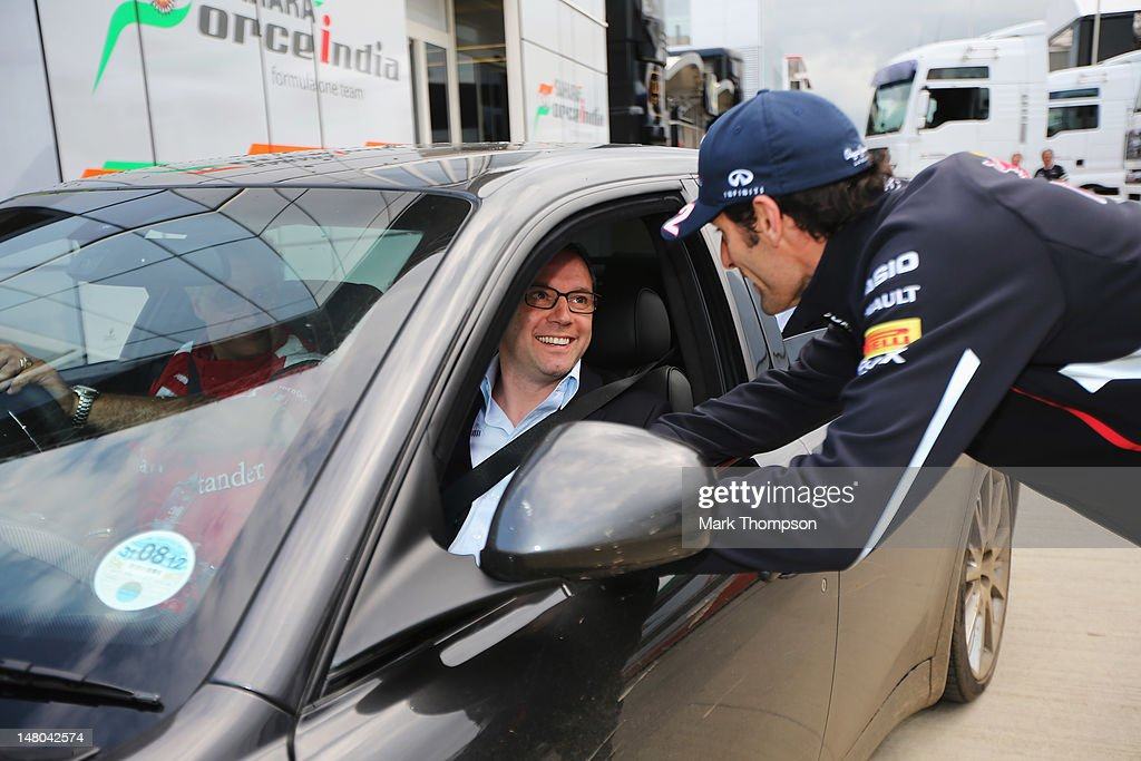 <a gi-track='captionPersonalityLinkClicked' href=/galleries/search?phrase=Mark+Webber+-+Race+Car+Driver&family=editorial&specificpeople=167271 ng-click='$event.stopPropagation()'>Mark Webber</a> of Australia and Red Bull Racing talks with Ferrari Team Principal <a gi-track='captionPersonalityLinkClicked' href=/galleries/search?phrase=Stefano+Domenicali&family=editorial&specificpeople=544864 ng-click='$event.stopPropagation()'>Stefano Domenicali</a> following the British Grand Prix at Silverstone Circuit on July 8, 2012 in Northampton, England.