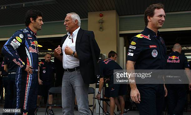 Mark Webber of Australia and Red Bull Racing talks with Red Bull Racing team owner Dietrich Mateschitz as team principal Christian Horner passes by...