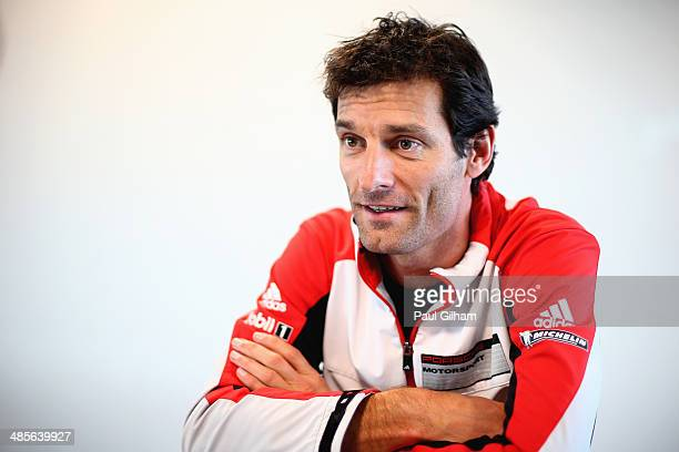 Mark Webber of Australia and Team Porsche talks to the media following qualifying in which he drove the Porsche Team Porsche 919 Hybrid LMP1 for the...