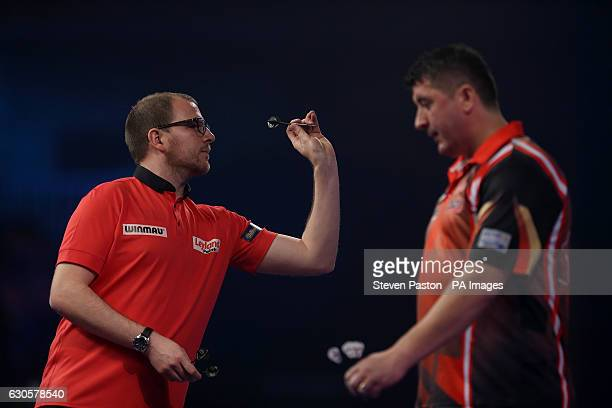 Mark Webster and Mensur Suljovic during day ten of the William Hill World Darts Championship at Alexandra Palace London