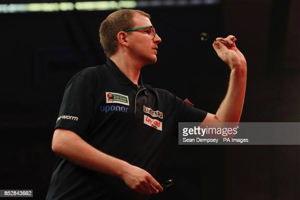 Mark Webster in action against Mensur Suljovic during day seven of The Ladbrokes World Darts Championship at Alexandra Palace London