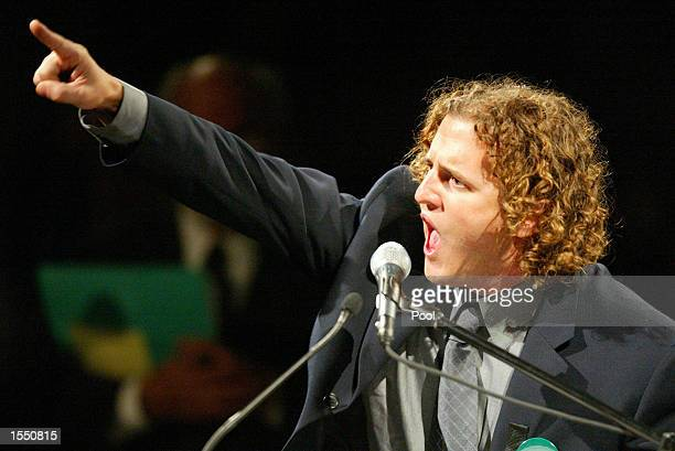 Mark Wellstone son of US Senator Paul Wellstone gestures as he chants 'We Will Win' at a public memorial service for his father US Senator Paul...