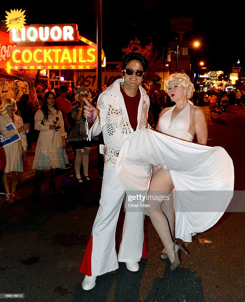 Mark Wilbur (L) of Ohio, dressed as Elvis Presley, and his wife Janice Wilbur dressed as Marilyn Monroe attend the fourth annual Las Vegas Halloween Parade on October 31, 2013 in Las Vegas, Nevada.