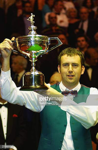 Mark Williams of Wales celebrates victory by posing with the trophy after the Final of the Embassy World Snooker Championships between Mark Williams...
