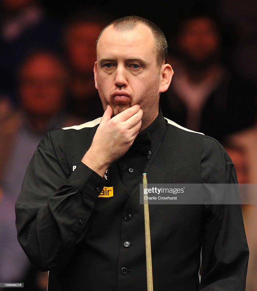 Mark Williams of Wales eyes up the balls during his quarter-final match against Mark Selby of England at Alexandra Palace on January 18, 2013 in London England.