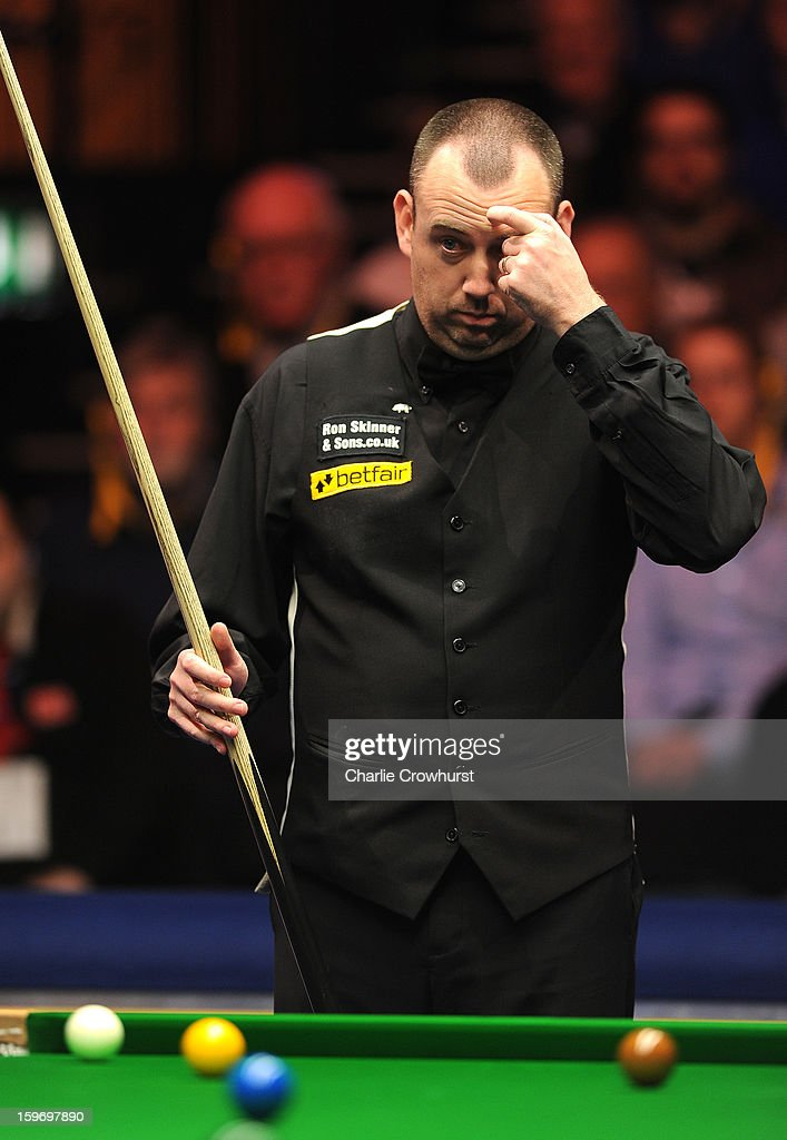 Mark Williams of Wales has a look for a shot during his quarter-final match against Mark Selby of England at Alexandra Palace on January 18, 2013 in London England.