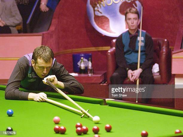 Mark Williams of Wales in action as Ken Doherty of Ireland looks on during the Final of the Embassy World Snooker Championships at the Crucible...