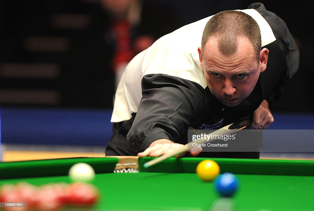 Mark Williams of Wales in action during his quarter-final match against Mark Selby of England at Alexandra Palace on January 18, 2013 in London England.