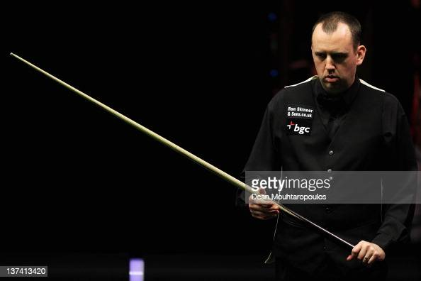 Mark Williams of Wales in action during his Quater Final match with Neil Robertson of Australia during day six of The Masters at Alexandra Palace on...