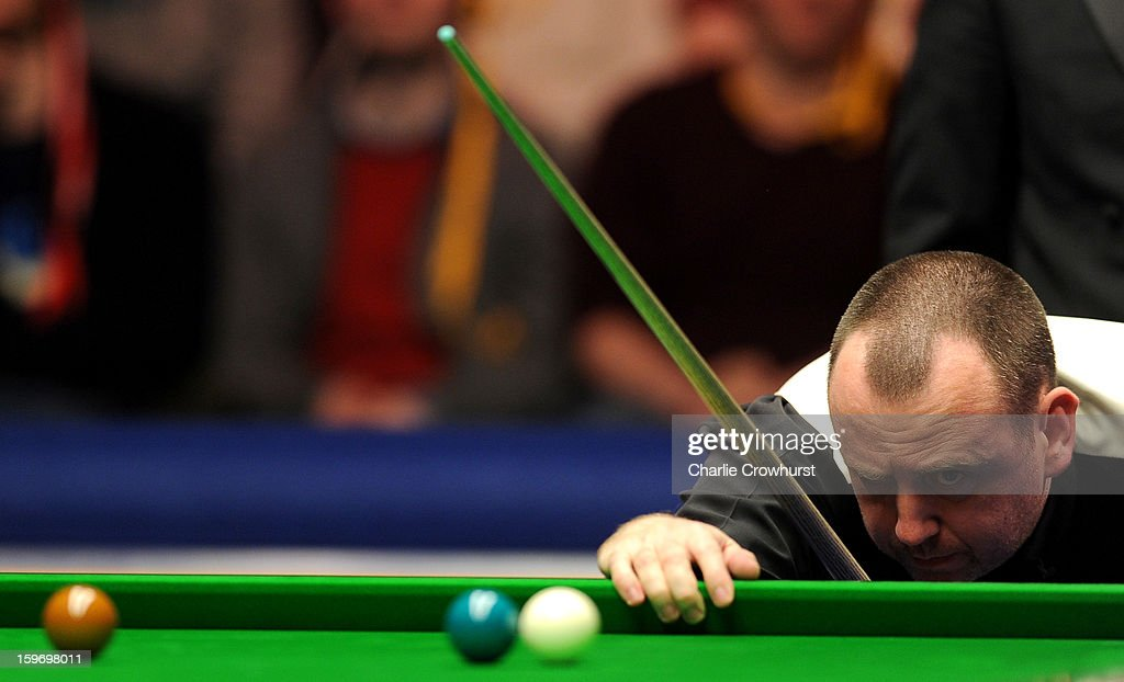 Mark Williams of Wales looks for a way out of a snooker during his quarter-final match against Mark Selby of England at Alexandra Palace on January 18, 2013 in London England.